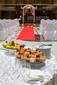 Empty hall for a wedding ceremony with table with snacks